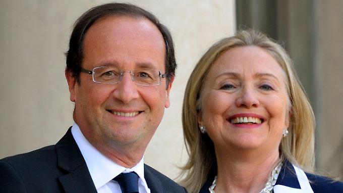 François Hollande und Hillary Clinton im Jahr 2014. Damals wusste noch keiner von ihrer weitläufigen Verwandschaft.