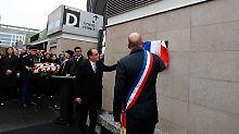Francois Hollande enthüllt die Gedenktafel vor dem Stade de France.