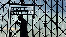 Nazisymbol aus Dachau aufgetaucht: Gestohlenes KZ-Tor in Norwegen entdeckt