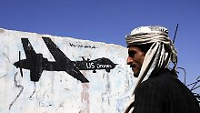 (170130) -- SANNA , Jan. 30, 2017 -- A Yemeni man walks near a painting of US drone on the wall in Sanaa, Yemen, on Jan. 29, 2017. At least 25 civilians were killed in the latest U.S. counter-terror raid in Yemen on Sunday, tribal and local sources in Baida province told Xinuha. ) YEMEN-US-AL-QAEDA-RAID MohammedxMohammed PUBLICATIONxNOTxINxCHN  Sanna Jan 30 2017 a Yemeni Man Walks Near a Painting of U.S. Drone ON The Wall in Sanaa Yemen ON Jan 29 2017 AT least 25 civilians Were KILLED in The Latest U S Counter Terror Raid in Yemen ON Sunday Tribal and Local Sources in Baida Province TOLD Xinuha Yemen U.S. Al Qaeda Raid MohammedxMohammed PUBLICATIONxNOTxINxCHN