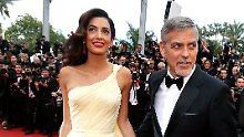 epa05302370 US actor George Clooney (R) and wife British human rights barrister Amal Clooney (L) arrive for the screening of 'Money Monster' during the 69th annual Cannes Film Festival, in Cannes, France, 12 May 2016. The movie is presented out of competition at the festival which runs from 11 to 22 May. EPA/SEBASTIEN NOGIER +++(c) dpa - Bildfunk+++