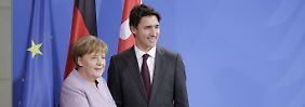 Sicherheitskonferenz in München: Merkel zeigt sich bei Treffen mit Trudeau einsichtig