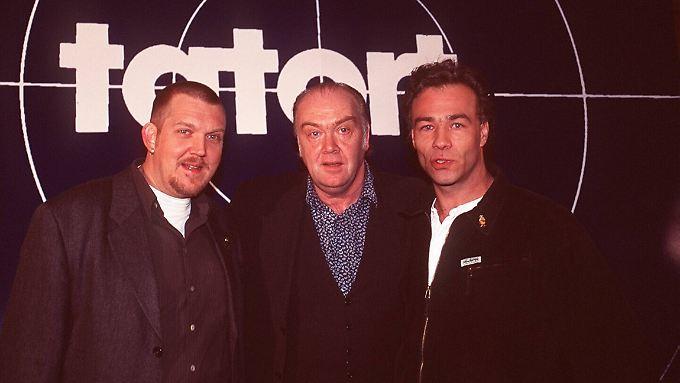"""Die Herren links und rechts, Dietmar Bär und Klaus Behrendt, spielen noch heute im """"Tatort"""". In den 90er-Jahren sah man sie an der Seite von Martin Lüttge."""