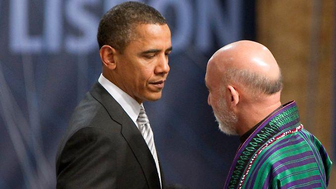 US-Präsident Obama mit dem ehemaligen afghanischen Präsidenten Karzai: Große Bargeld-Lieferungen