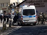 Schüsse bei Überfall: Polizei überwältigt Bankräuber