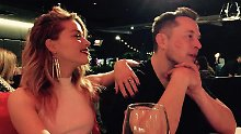 Da guckt der Johnny deppert: Amber Heard turtelt mit dem Tesla-Chef