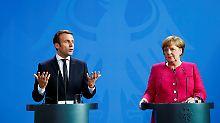 Treffen mit Macron in Berlin: Merkel zu Reform von EU-Verträgen bereit