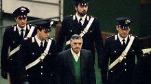Riina (Mitte) 1993 bei einem Gerichtstermin.