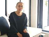 Erstes Lebenszeichen seit Wochen: Liu Xiaobos Witwe taucht in Video auf
