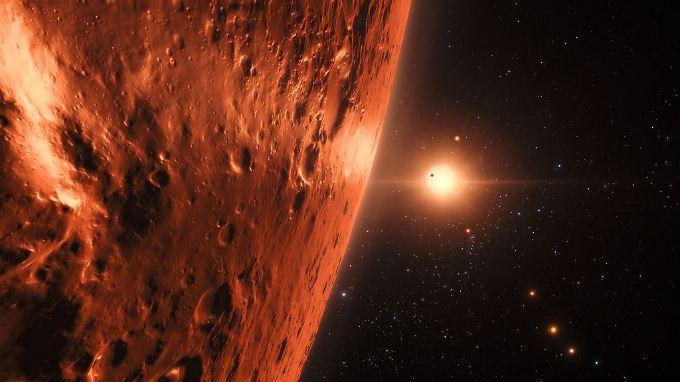 Der Stern Trappist-1 wird von sieben Planeten umkreist - die sich hier ein Künstler vorgestellt hat.