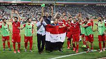 Nun in den Playoffs gegen Australien: Syriens Fußballer im Teheraner Asadi-Stadion.