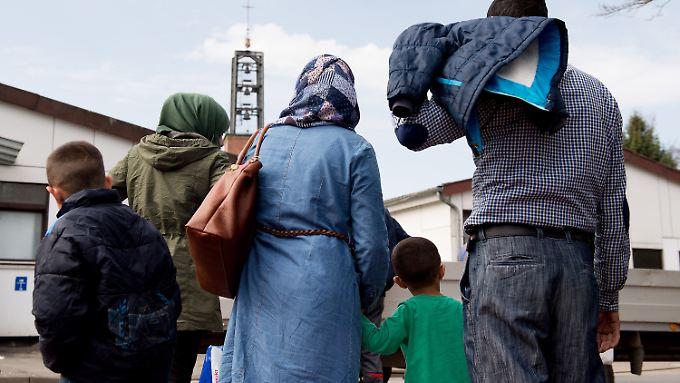 Die Unionsparteien einigen sich auf einen Grenzwert von 200.000 Flüchtlingen pro Jahr.