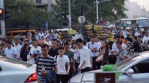Schwarzmarkt für Nummernschilder: Peking versinkt im Verkehrschaos