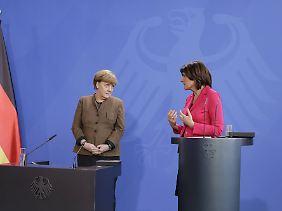 Bundeskanzlerin Angela Merkel und die die rheinland-pfälzische Ministerpräsidentin Malu Dreyer bei einer Veranstaltung im Februar.