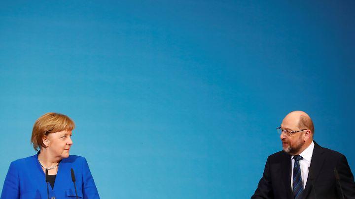 Kanzlerin Angela Merkel und SPD-Chef Martin Schulz wollen die Große Koalition. Ob sie auch kommt, hängt vom Votum der SPD-Mitglieder ab.