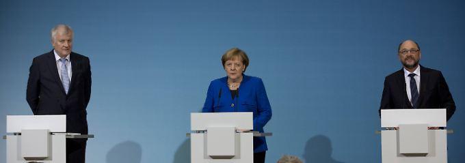 Horst Seehofer, Angela Merkel und Martin Schulz nach der durchsondierten Nacht.