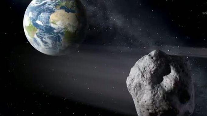 Die Darstellung zeigt einen erdnahen Asteroiden, der an der Erde vorbeifliegt.