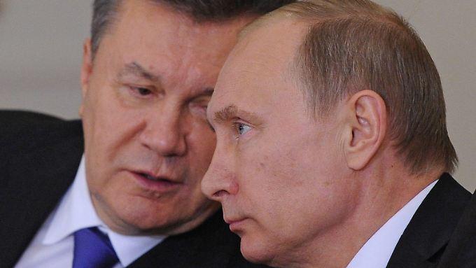 Über Umwege: Die Deutsche soll Geschäftsführerin einer angeblichen Lobby-Organisation des früheren ukrainischen Präsidenten Viktor Janukowitsch (l) gewesen sein.