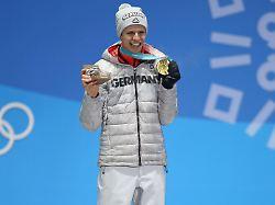 Das bringt der Olympia-Montag: Wird's goldig für Skispringer und Bobpiloten?