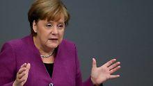 Geld und Flüchtlingsfrage: Merkel sieht Finanzkonflikt in EU aufziehen