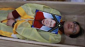 Workshop zwischen Sinnsuche und Suizid: Südkoreaner beerdigen sich selbst