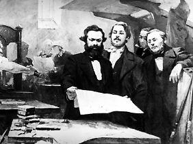 Karl Marx und Friedrich Engels beim Druck eines Entwurfs des Kommunistischen Manifests 1848.