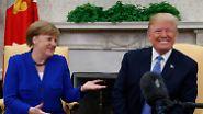 Küsschen und Getätschel: Trump umschmeichelt Merkel beim Empfang