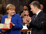 """Für die """"ruhige Supermacht"""": Merkel erhält Assisi-Lampe"""