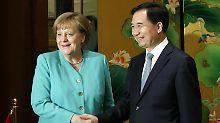 """Elektroautos hier, Hunger dort: China führt Merkel seine """"Effizienz"""" vor"""