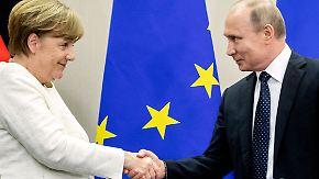 Arbeitstreffen auf Schloss Meseberg: Merkel und Putin proben pragmatische Annäherung