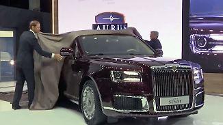 Autosalon für kleine und riesige Geldbörsen: Putins neue Staatskarosse fährt mit Porsche-Motor