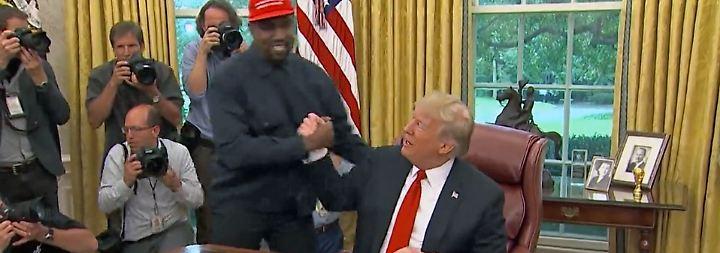 """""""Fühlte mich mit Mütze wie Superman"""": Kanye West preist Donald Trump im Weißen Haus"""