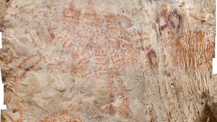 Zeichnungen auf Stein aus einer Höhle auf Borneo. Sie sollen mindestens 40.000 Jahre alt sein.