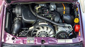 Der 3,6 Liter mit vergrößertem luftgekühltem Boxermotor und serienmäßigem Drei-Wege-Katalysator war dank Doppelzündung sparsamer als sein Vorgänger.