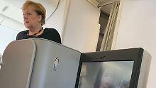 Per Linienjet nach Argentinien: Merkel beeindruckt ihren Sitznachbarn