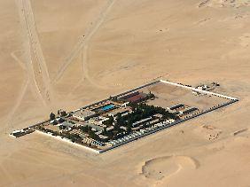 Das Camp der BASF-Tochter Wintershall in der libyschen Wüste. Der Konzern hat bereits Mitarbeiter abgezogen.