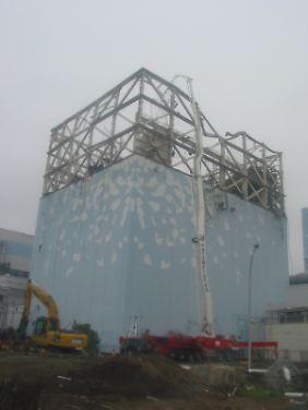 Reaktorblock 1 des AKW Fukushima. Nicht nur hier frisst sich die strahlende Masse langsam durch den Boden.