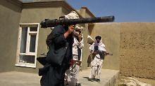 Taliban-Kämpfer in Süd-Afghanistan im Mai 2011.