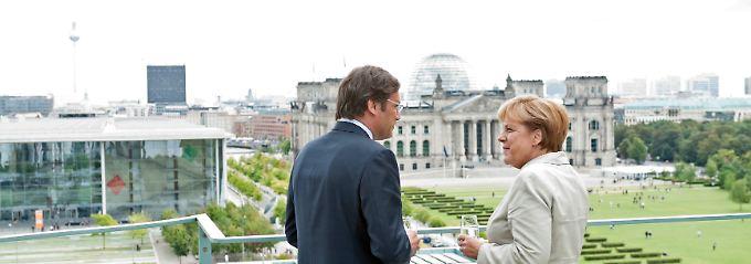 Zu Besuch in Berlin: Pedro Passos Coelho (links).