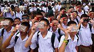 Schauspiel über Asien: Drache verschluckt Sonne