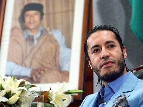 Al Saadi ist eines von acht Kindern des gestürzten Diktators.