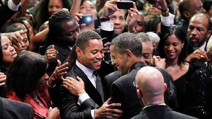 Barack Obama begrüßt beim Congressional Black Caucus den Schauspieler Cuba Gooding.