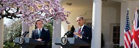 Cameron (l.) und Obama bei der Pressekonferenz im Rosengarten des Weißen Hauses.