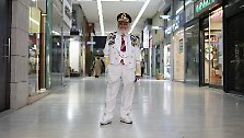 Christos Vassiliou, 79, retired sausage maker, poses for a picture in a shopping centre in central Athens March 28, 2012. When asked how he had been affected by the economic crisis, Vassiliou replied, 'my pension has been cut by 250 euros ($334) a month. If it continues like this I will be thrown out of my house because I can't afford my rent.' Picture taken March 28, 2012.
