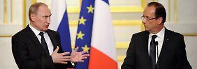 Keine neue Männerfreundschaft erkennbar: Putin und Hollande.