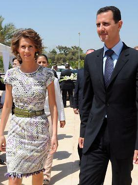 Das Ehepaar Assad bei einem Staatsbesuch in Tunesien.