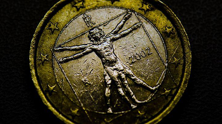 Italienische Euo-Münze: Vielen Bürgern Italiens graut es vor der Schulden-Party der neuen Regierung.