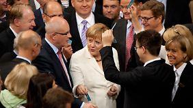 Die Kanzlerin bei der Abstimmung im Bundestag.