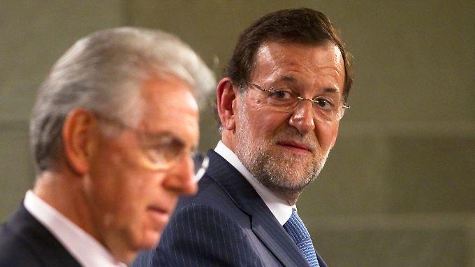 Monti und Rajoy versuchen der Euro-Schuldenkrise Herr zu werden.