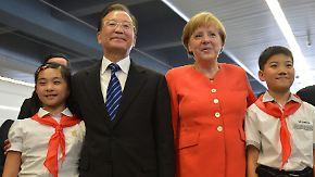 Gegenseitige Abhängigkeit: Merkel und Wen bekräftigen Partnerschaft